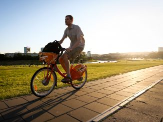On the Orange Bike in Vilnius on a summer evening