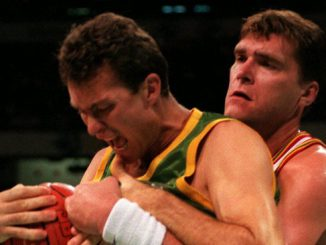 Australia's John Dorge (left) is grabbed by Lithuania's Arvydas Sabonis during the playoff for bronze at the 1996 Atlanta Olympic Games. Picture courtesy of Basketball Australia.