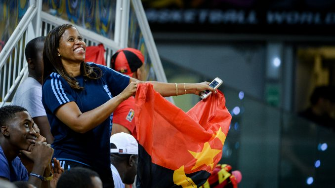 Angolan basketball team supporter with Angolan flag
