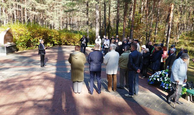 Misha (Meyshke) Shapiro (at left), head of a region's tiny remnant Jewish community, chairs the annual commemoration in the forest at a mass grave where 8,000 Jews were killed in two days in October of 1941. Photo defendinghistory.com