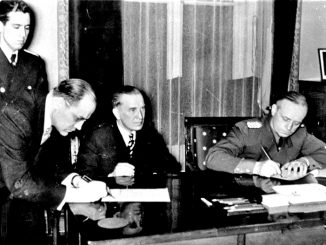 Lithuania's ambassador to the Nazi Germany Kazys Škirpa signs the act of the Klaipėda region hand over to the Nazi Germany. Seated Lithuania's ForMin J. Urbšys and his German counterpart  J. von Ribentrop.  1939 March 23 d.