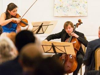 Dalia Dedinskaitė, violin and Gleb Pyšniak, cello performing Ravel at the Lithuanian Embassy in Washington      Photo Ludo Segers