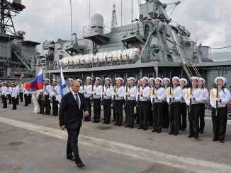 Vladimir Putin and Russian navy soldiers