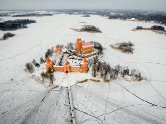 Trakai Castle surrounded by a frozen lake