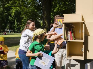 The little library in Bernardino Park being stocked with books   Photo © Ludo Segers @ The Lithuania Tribune