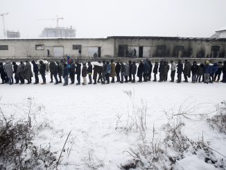 Refugees in Serbia waiting for food